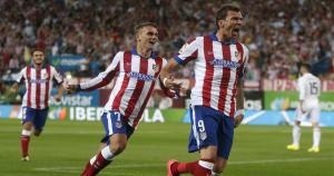 El primer gol del partido fue al minuto de iniciado. El Atlético lleva la ventaja parcial. (Reuters)
