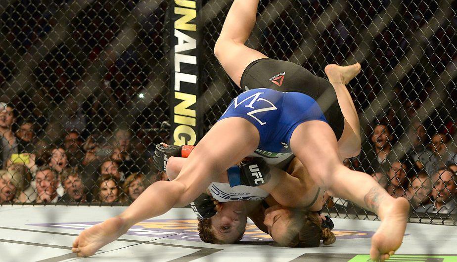 Ronda Rousey venció a Cat Zingano en tan solo 14 segundos. (Reuters)